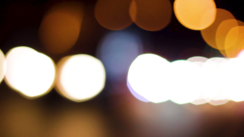 out of focus beautiful glittering blurred bokeh of cars and traffic lights at night. Blurred city traffic jam on city street. defocused colorful lights of traffic jam in city street Royalty-Free Stock Footage #1061631424