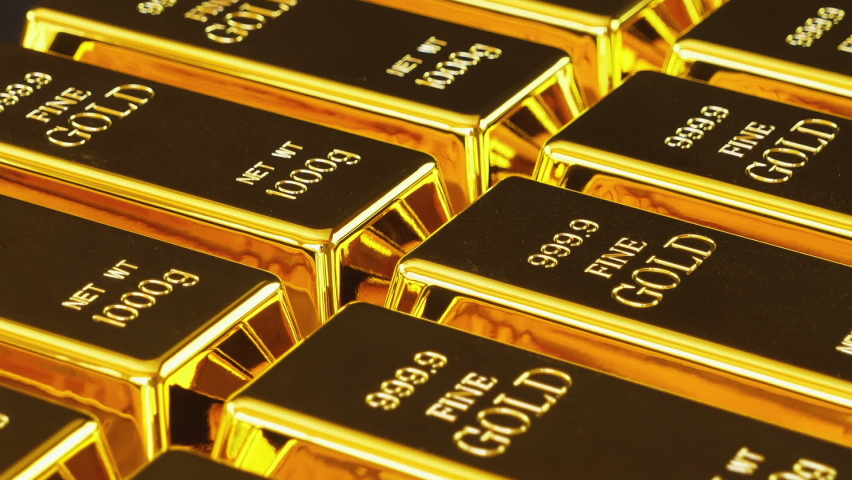 Gold bars stacked in a row. Gold bricks. Stack of gold bullion bars. Seamless looping footage. The camera pans around gold bars in close up. Royalty-Free Stock Footage #1061648014