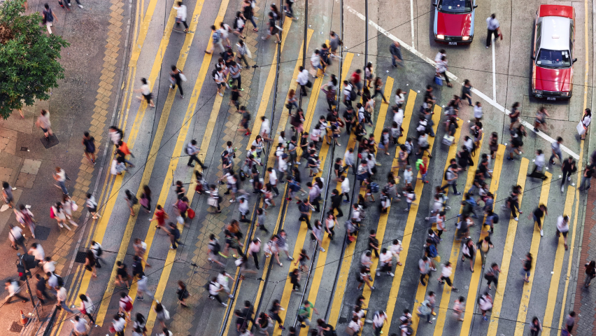 TL/ Asia, China, Hong Kong, 11-15-2019, Zoom Out Time lapse of people crossing the road using Pedestrian crossing in central shopping district during evening rush hour, aerial view | Shutterstock HD Video #1061665888