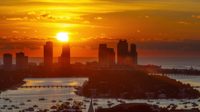 Time Lapse of the sun rising from behind the tall buildings on Miami Beach Florida