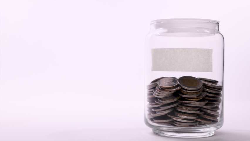 Coin in saving jar with empty label - Stop motion Royalty-Free Stock Footage #1061688244