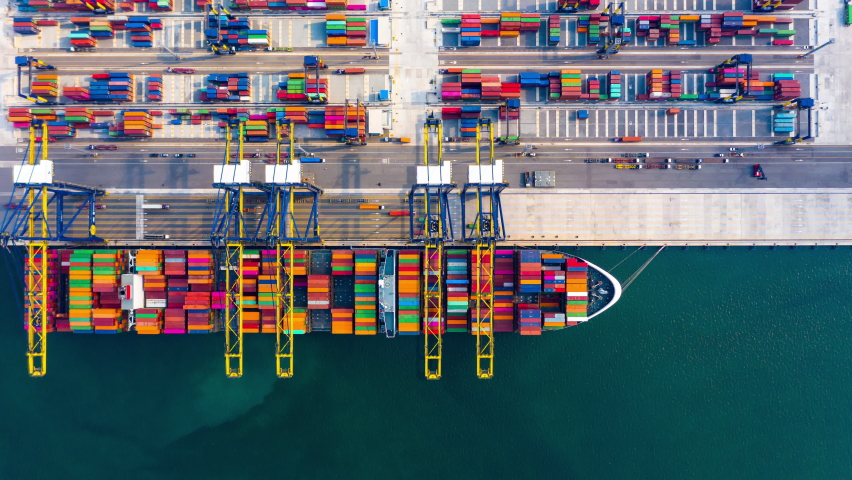 4k footage aerial view timelapse container ship carrying container in import export business logistic and transportation of international by container cargo freight ship at industrial port
