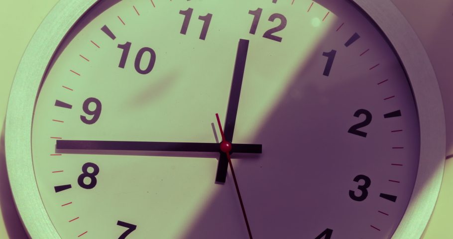Wall clock show the running time. Time lapse on a modern wall clock.  Close up to a wall clock, with running time pointer. Sun and sky reflecting in the watch during the time passing by | Shutterstock HD Video #1061698591