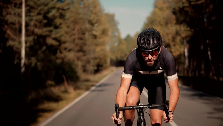 Hard Sport Workout.Triathlete Cyclist Training On Bicycle.Fit Athlete Sport Workout Training Cycling Triathlon Competition.Cyclist Fitness Riding On Road Bike Ready For Triathlon Race.Recreation Sport Royalty-Free Stock Footage #1061708968