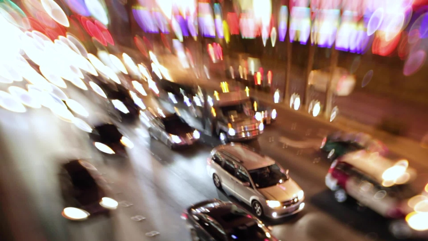 LAS VEGAS, NEVADA - CIRCA 2020 - Selective focus image of the electricity and energy of bright lights and traffic on the strip at night in Las Vegas. | Shutterstock HD Video #1061724904