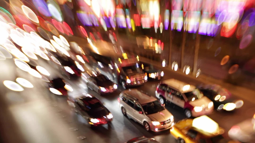 LAS VEGAS, NEVADA - CIRCA 2020 - Selective focus image of the electricity and energy of bright lights and traffic on the strip at night in Las Vegas. | Shutterstock HD Video #1061724928