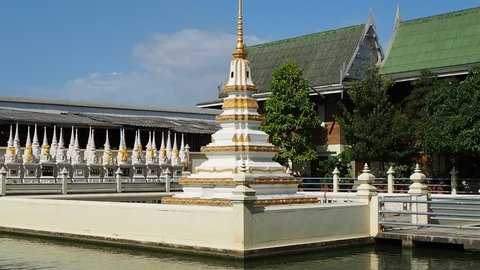 White chedi in the middle of a pond