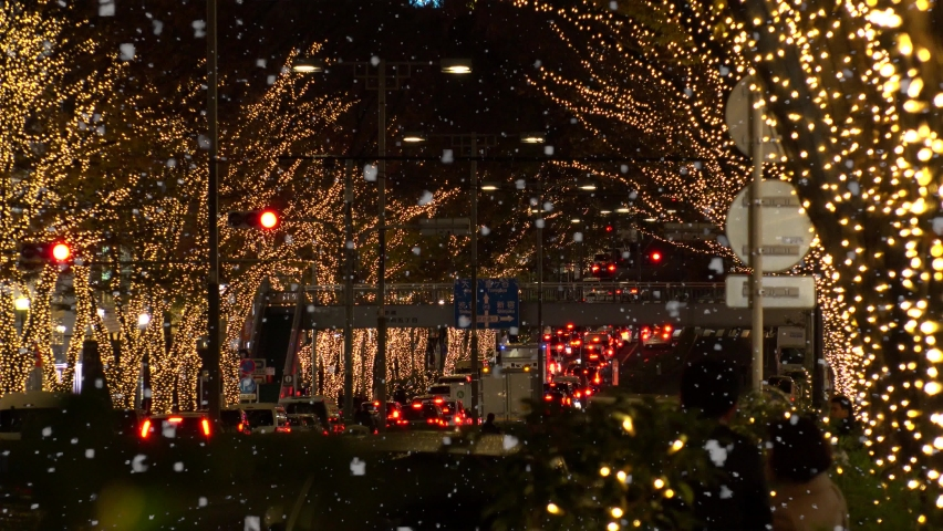 TOKYO, JAPAN - DECEMBER 2019 : Christmas illumination and snow at Omotesando and Harajuku shopping area. Scenery of downtown city and street at night. Japanese Winter and Christmas season concept. | Shutterstock HD Video #1061748604