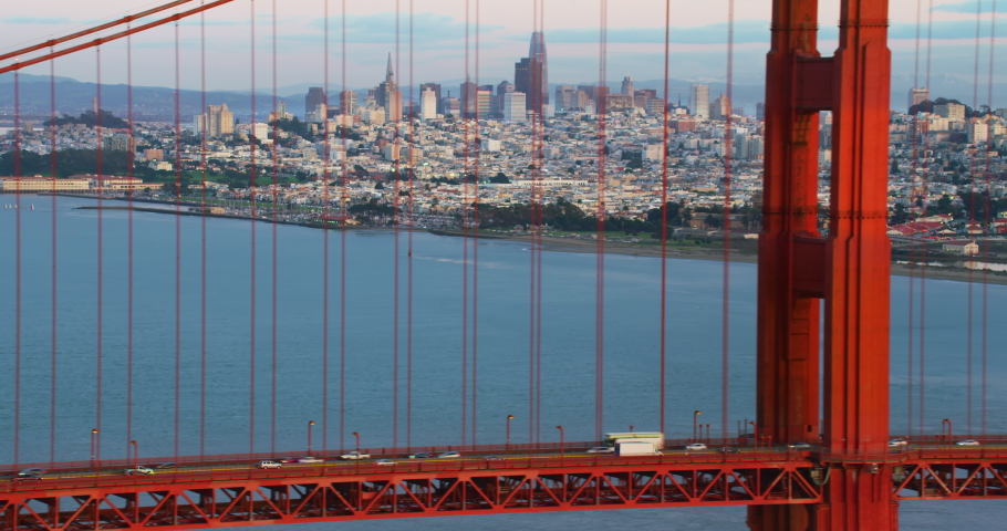 Aerial view of the magnificent Golden Gate Bridge with traffic. This bridge connects the San Francisco peninsula to Marin County. US route 101 and SR 1 full of cars. Red 8K.  Royalty-Free Stock Footage #1061773492