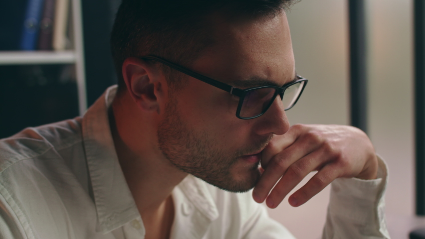 Closeup of stressed businessman working on laptop, taking off glasses, looking shocked after reading bad news, covering face with hands in despair. Chief executive manager made mistake, lost job. Royalty-Free Stock Footage #1061776564