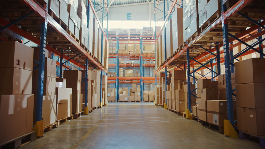 Gigantic Retail Warehouse full of Shelves with Goods in Cardboard Boxes. Logistics and Distribution Storehouse Center for further Product Delivery Packages. Dolly Zoom Walkthrough Camera View Royalty-Free Stock Footage #1061780536