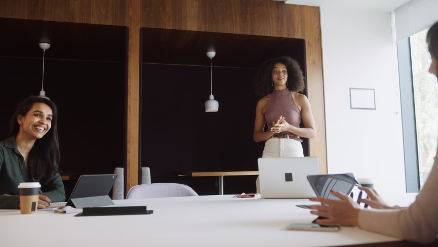 Three Businesswomen Having Socially Distanced Meeting In Office During Health Pandemic   Shutterstock HD Video #1061794027