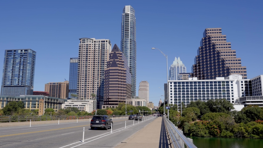 Slow Motion of Car Driving on South Congress Bridge at Downtown Austin, Texas