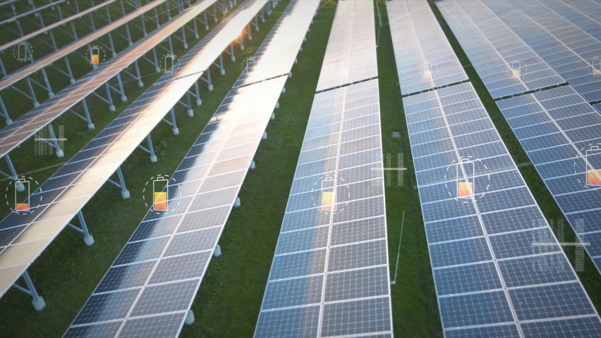 Solar panel farm generating electricity for national grid with a motion graphic indicator of battery charging. New green energy concept Royalty-Free Stock Footage #1061806084