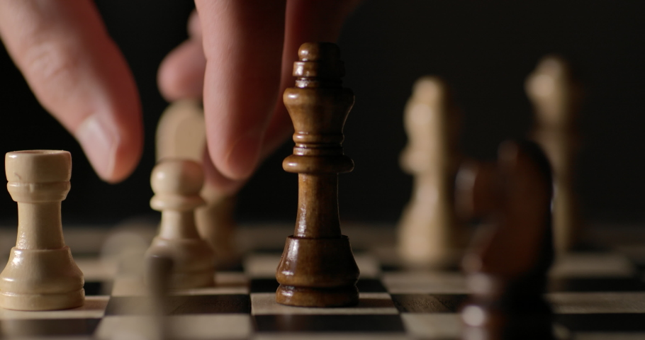 Game of Chess. Close Up of Hand Confident Businessman Playing Chess Game to Development Analysis Strategy Plan, Leader and Teamwork Concept for Success. Business Solutions, Success Strategy. Royalty-Free Stock Footage #1061833636