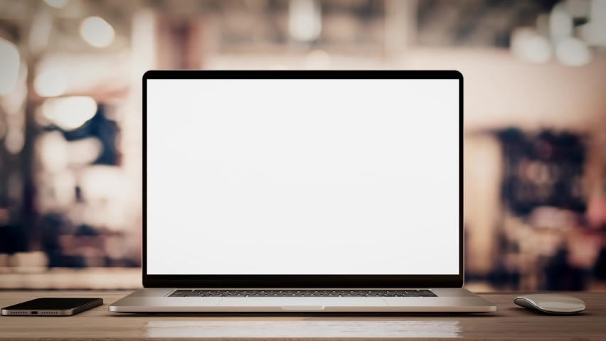 Laptop with blank screen on table smooth zoom in with mouse and smartphone. factory or loft background, 4k 30fps UHD   Shutterstock HD Video #1061841448
