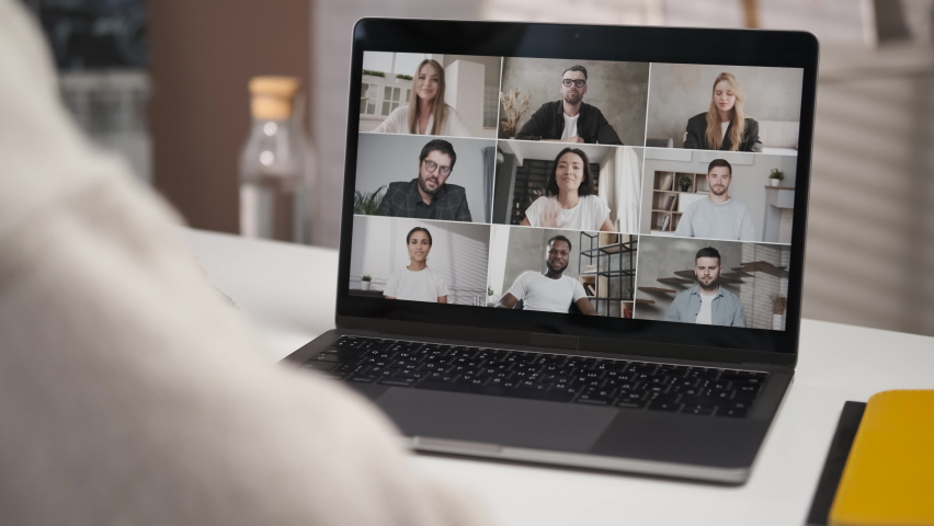 Discussing project online. Over shoulder close up view. Group video call. Remote communication of happy multiracial young people. Working from modern home office. Business chat conference. Closeup 4K | Shutterstock HD Video #1061857141