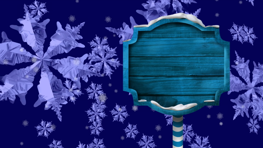 Digital animation of blue wooden signpost against snowflakes falling on blue background. christmas festivity celebration tradition concept