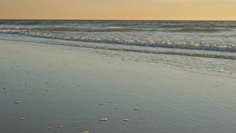 Layers of waves on the beach at dusk