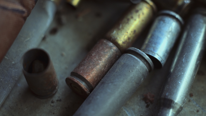 The empty machine gun shells. Close-up.