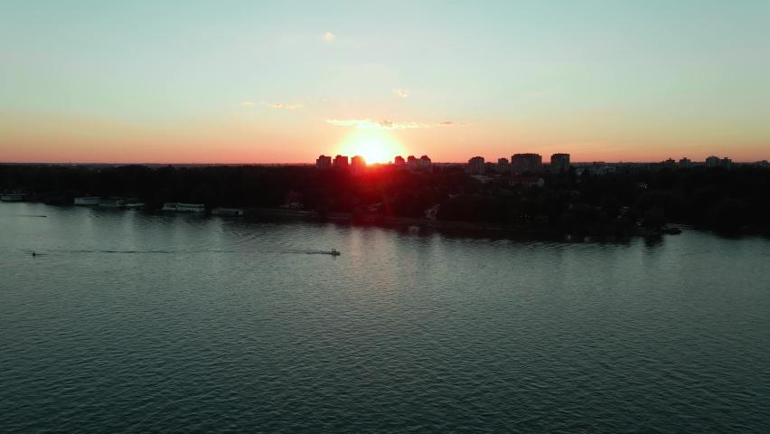 Beautiful sunset with boat and river Danube Novi Sad Serbia. | Shutterstock HD Video #1061890306