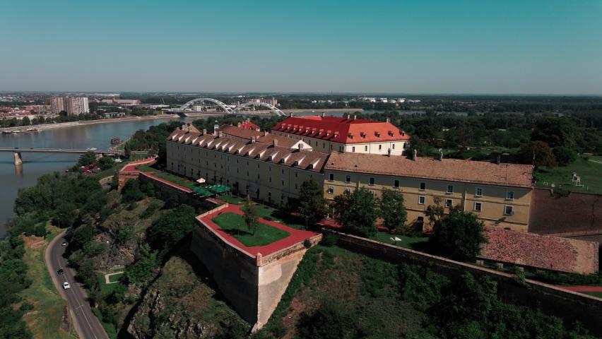 Beautiful aerial drone footage view on Petrovaradin fortress over Danube river, Novi Sad, Serbia. | Shutterstock HD Video #1061890387