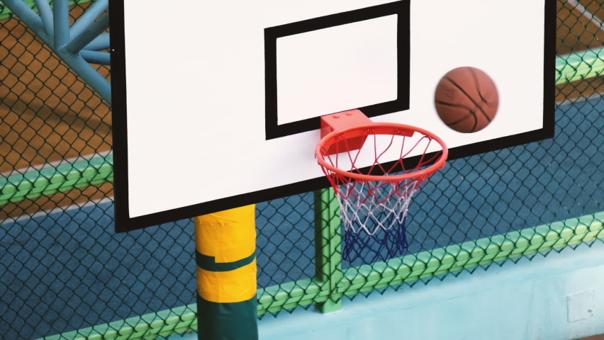 Slow motion of basketball missing rim and doesn't fall through hoop Royalty-Free Stock Footage #1061891317