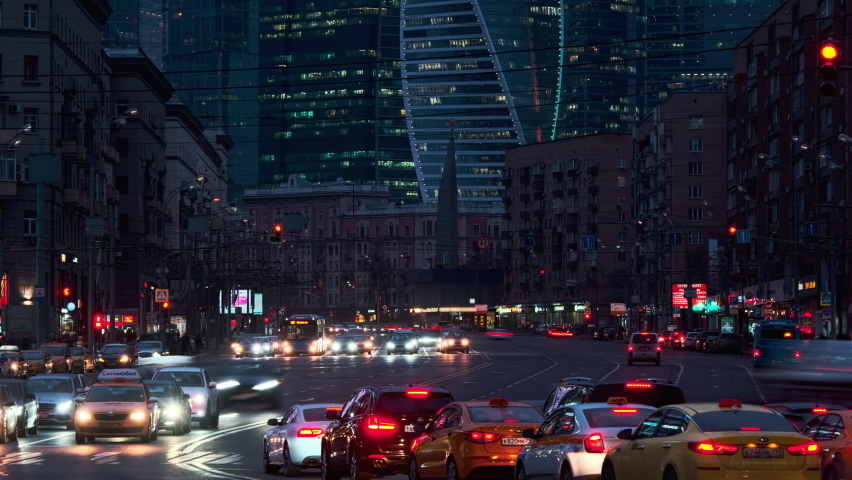 Timelapse of busy crossroad at modern european city. Modern City at Night. Cars, Lights, Contemporary Buildings in front of Moscow City. Cinematic View of beautiful town at Night. Royalty-Free Stock Footage #1061900227