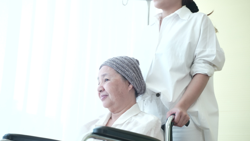Asian woman with her mother who patients into the cancer, hugging for hope and take care in bed of hospital | Shutterstock HD Video #1061918509