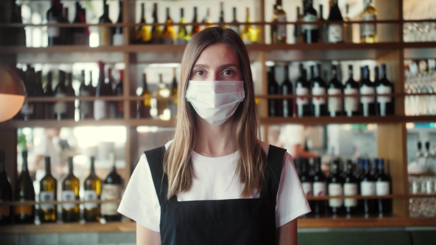 Coffee Shop restaurant Woman Owner Working With Face Mask, Open After Lockdown coronavirus Quarantine is over. business owner waiter waiting customers, supermarket food store, wine shop Royalty-Free Stock Footage #1061925055