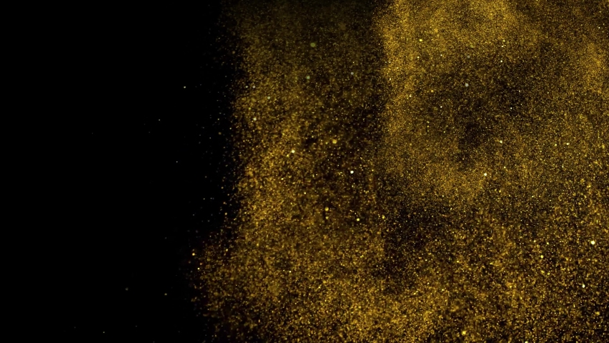 Gold dust particles fly in slow motion in the air lingering slowly.  | Shutterstock HD Video #1061931352