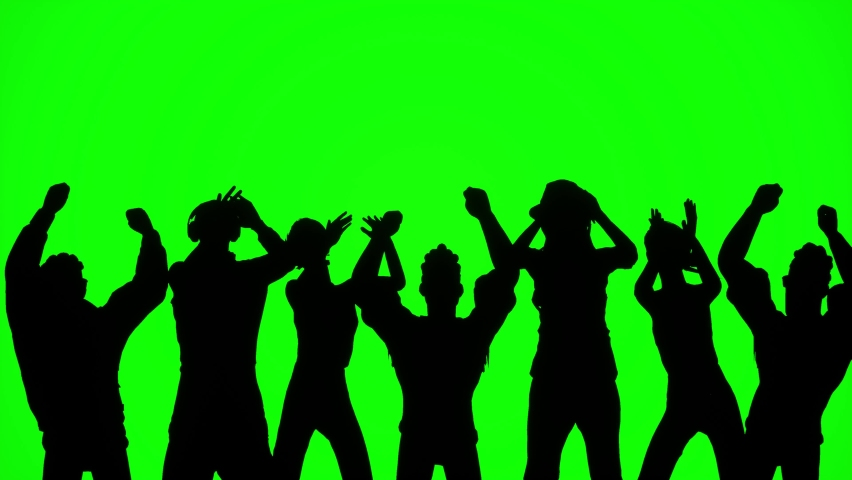 Crowd of people clapping and jumping at a concert. Silhouette of people cheering at a party. Group of fans at a concert on a green screen.