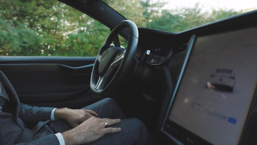Modern car driving on autopilot. Autopilot in car. Intelligent vehicle driveless automobile concept. Hands free system. Vehicle autonomous self-driving.