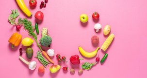 Fresh organic vegetables and fruits move into a pile on a pink background, stop motion. Vegetables animation. Flat lay 4 video with vegetables.