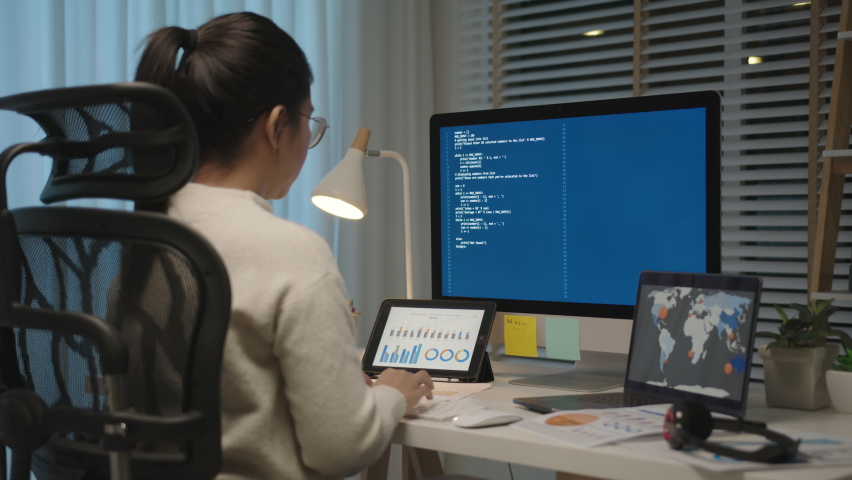 Back rear view of young asian woman, freelance data scientist work remotely at home coding programing on Big data mining, AI data engineering, IT Technician Works on Artificial Intelligence Project. Royalty-Free Stock Footage #1061972413