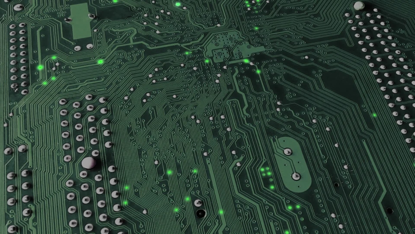 Animation electronic signal move and flash along the surface tracks of the green circuit board. Motherboard close up. Graphical  of the concept of work computer technology. Royalty-Free Stock Footage #1061980063