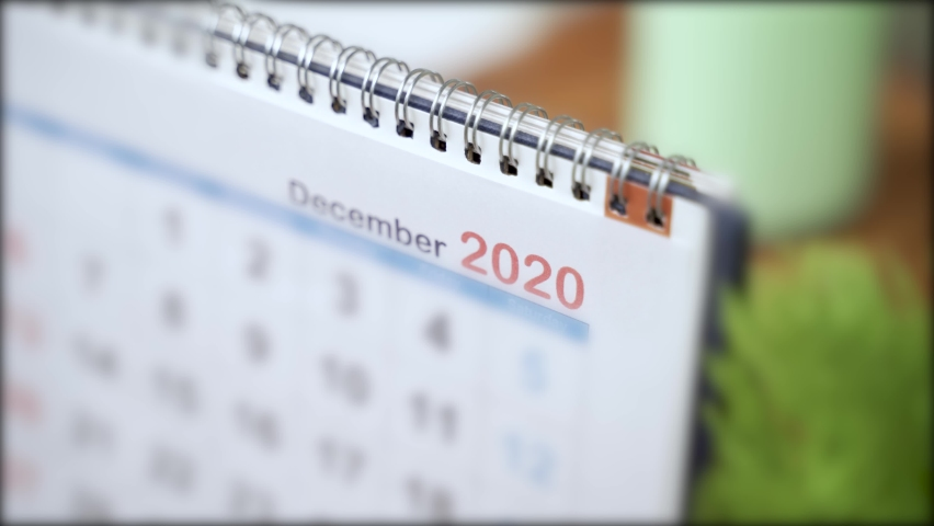 Close up of calendar Changing from December 2020 to January 2021 - concept of beginning or starting of new year 2021 Royalty-Free Stock Footage #1061987041