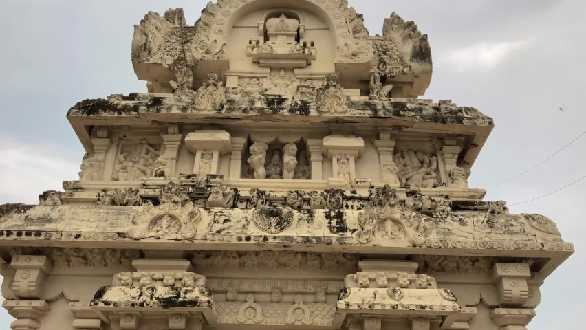 Beautiful sandstone ancient historical carvings of God, animal sculpture on the walls of Kanchi Kailasanathar temple in Kanchipuram, Tamilnadu. View of historic temple tower with carved sculptures. Royalty-Free Stock Footage #1061992225