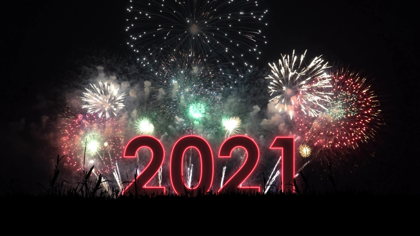 Red text 2021 with particles and sparks with colored  fireworks on background. New year celebration.  | Shutterstock HD Video #1061995720