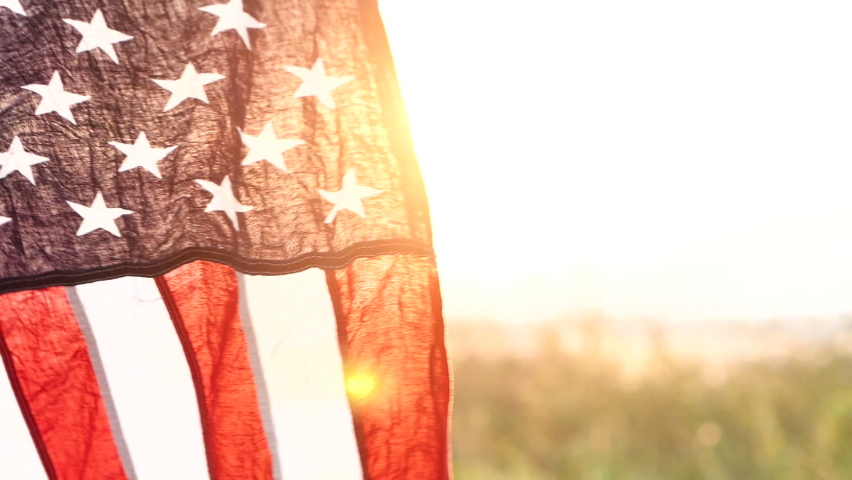 Close up American flag waving on sunset with soft focus, Slow Motion. Concept of Memorial Day or 4th of July, Independence Day, Veterans Day, Celebrate USA, American Election. America Concept. Royalty-Free Stock Footage #1061999302
