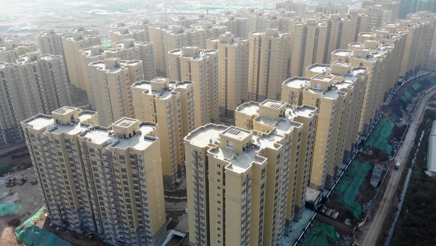 Aerial of new apartment building complex in China. Drone shot of Asian newly constructed residential towers in Xichang. Real estate development in dense populous city. Royalty-Free Stock Footage #1062019276
