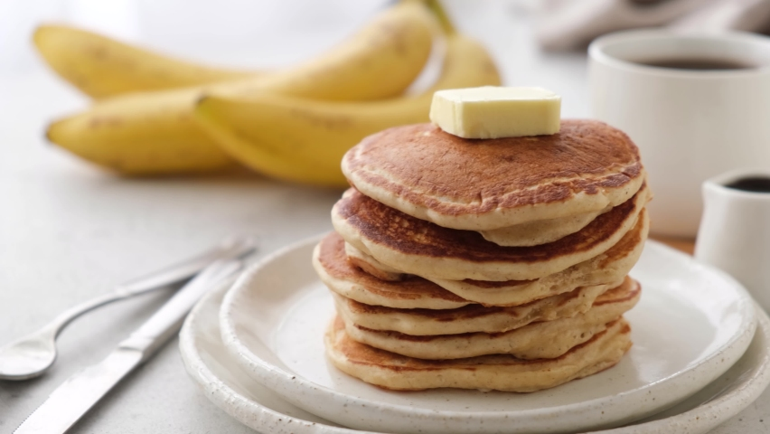 Stack of pancakes with butter. Fluffy american buttermilk pancakes Royalty-Free Stock Footage #1062021595