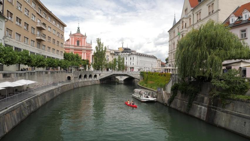 View of Ljubljanica river, Prešernov trg square and triple bridge in Ljubljana, Slovenia Royalty-Free Stock Footage #1062026128