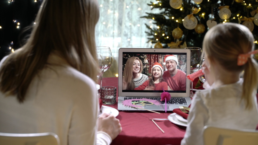 Two happy families with a children celebrating Christmas using a video call. Family greeting their relatives and friends on Christmas eve online. Social distancing, self isolation during quarantine | Shutterstock HD Video #1062028729