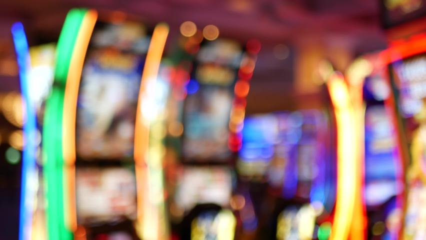 Defocused slot machines glow in casino on fabulous Las Vegas Strip, USA. Blurred gambling jackpot slots in hotel