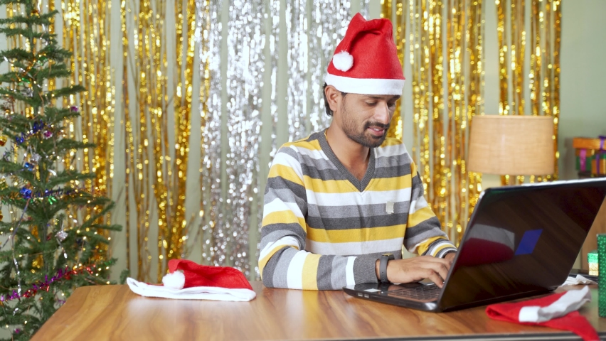 Young man ordered gift online on laptop and got the gifts instantly during christmas or new year eve - Concept of instant ecommerce product delivery during holyday festive sale Royalty-Free Stock Footage #1062049939
