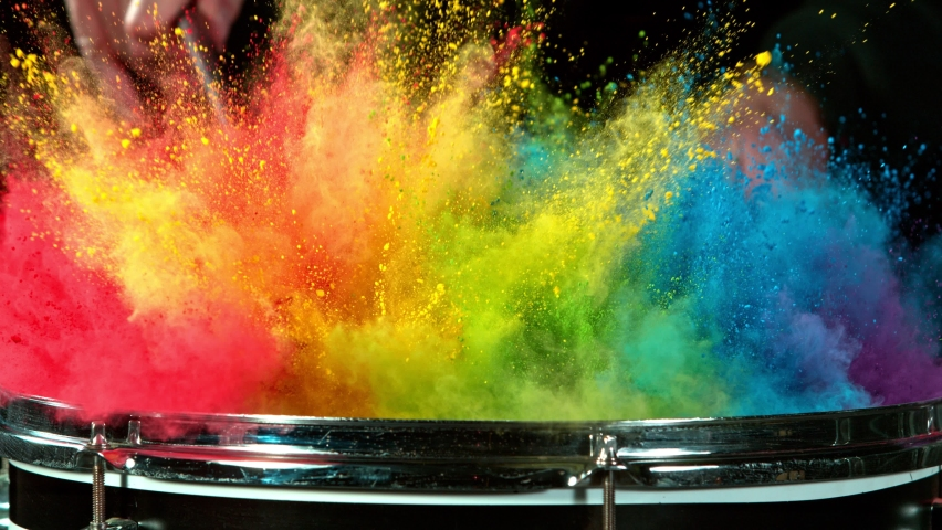 Super Slow Motion Shot of Drum Hit with Color Powder Explosion at 1000 fps.