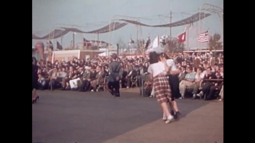 CIRCA 1930s - Glenn Gray's band performs and girls dance together at the 1939 New York World's Fair.