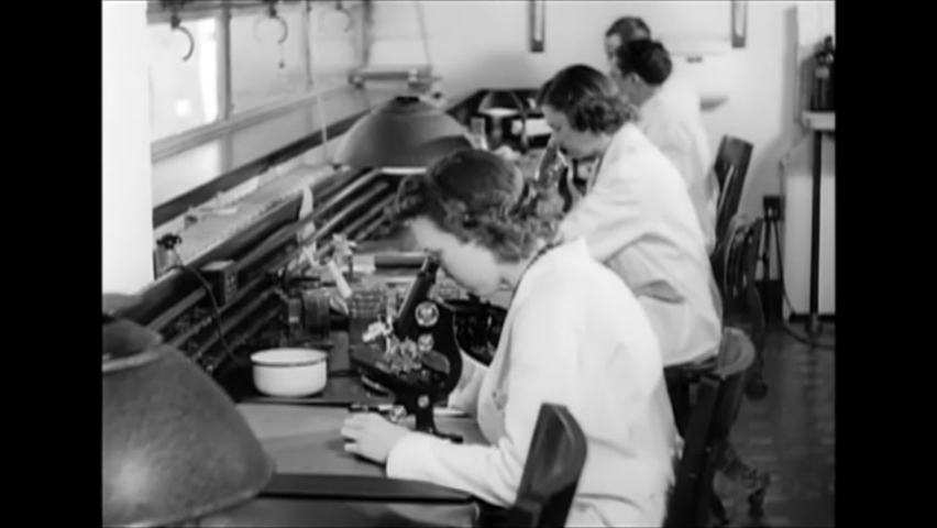 CIRCA 1940s - A pathologist diagnoses cancer and surgeons operate on a patient, in 1940.