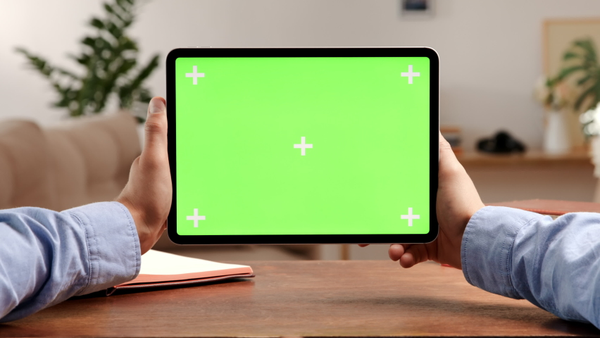 Tablet computer with green screen and chroma key for video conference. Mockup of mobile PC with greenscreen close-up. POV: businessman chatting on remote working or watching online content on device Royalty-Free Stock Footage #1062111763